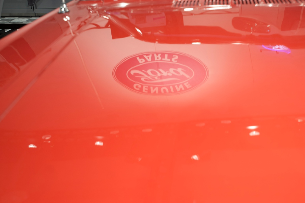 Restored 1964 1/2  mustang convertible _hood reflection_Ford Display_The SEMA Show 2011_11/4/11