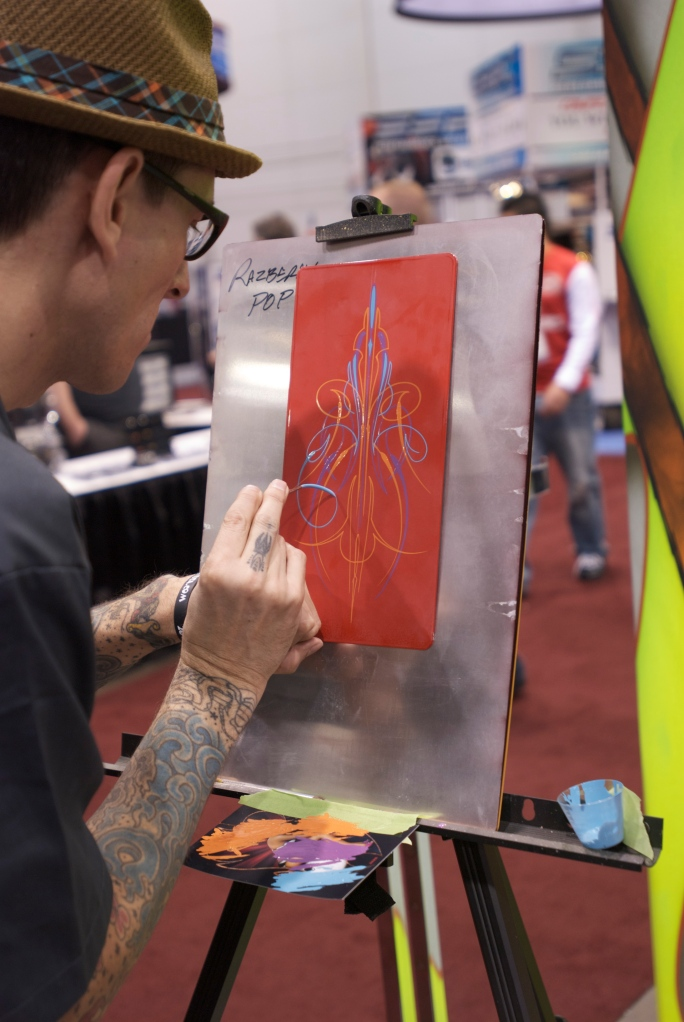 Pin stripe artist at work_Dupont paint display_The SEMA Show 2011_11/4/11