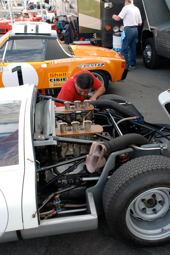 Dieter Inzenhofer of Andial fame in white shirt working on Jeff Zwart's Porsche 906_Rennsport Reunion 4_10/16/11