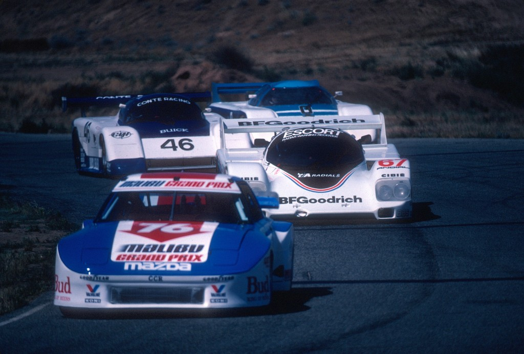 #67 BFGoodrich Porsche 962 in traffic_Riverside Raceway_April 1985