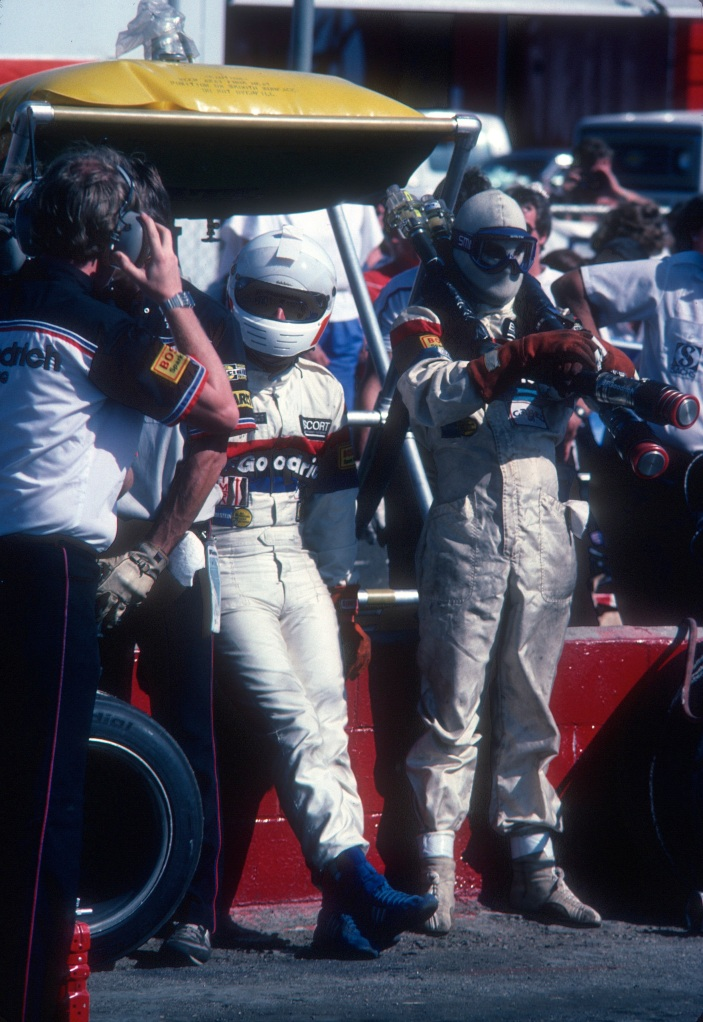 Rick Knoop waiting to make driver change with Jim Busby_#67 BFGoodrich Porsche 962_Riverside Raceway_April 1985