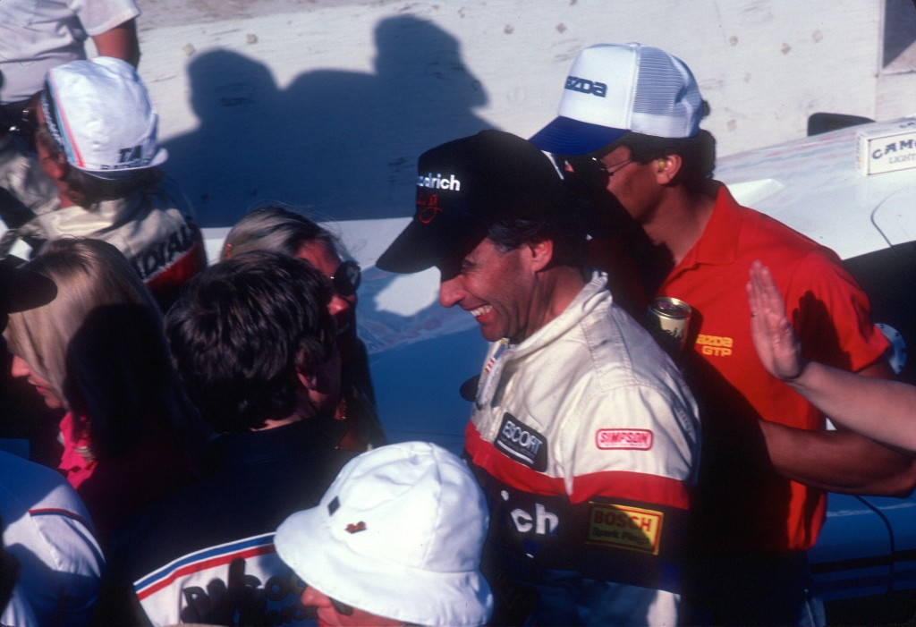 Jim Busby, team owner and driver of car #67, celebrating his teams first and second place finish_Riverside Raceway_April 1985