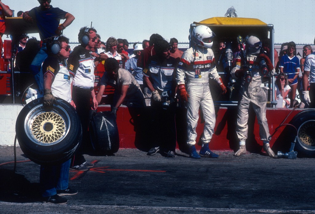 Rick Knoop & crew chief Jim Tully and crew ready for #67 BFGoodrich Porsche 962 driven by Jim Busby to pit_Riverside Raceway_April1985