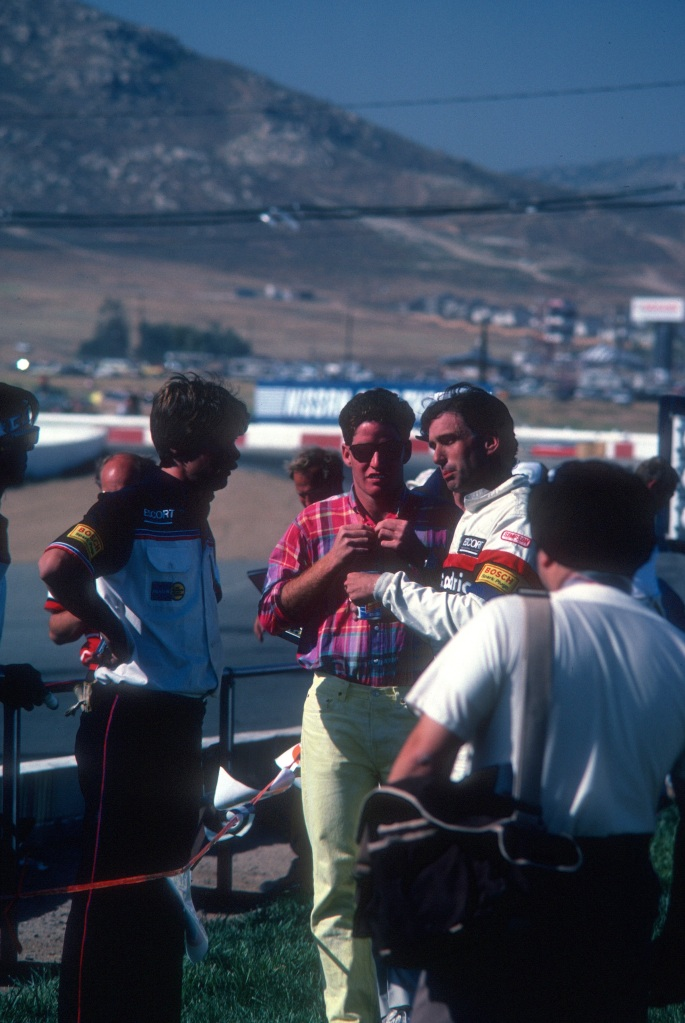 Jim Busby and son and a crew member discussing the teams 1-2 race victory_Riverside Raceway_April 1985