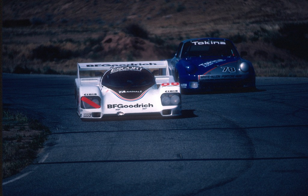 #68 BFGoodrich Porsche 962_in traffic, turn 8  _Riverside Raceway_April 25, 1985
