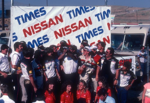 Entire Jim Busby Racing team and crew- celebrating their teams 1st and 2nd place victory_Riverside Raceway_April 25, 1985