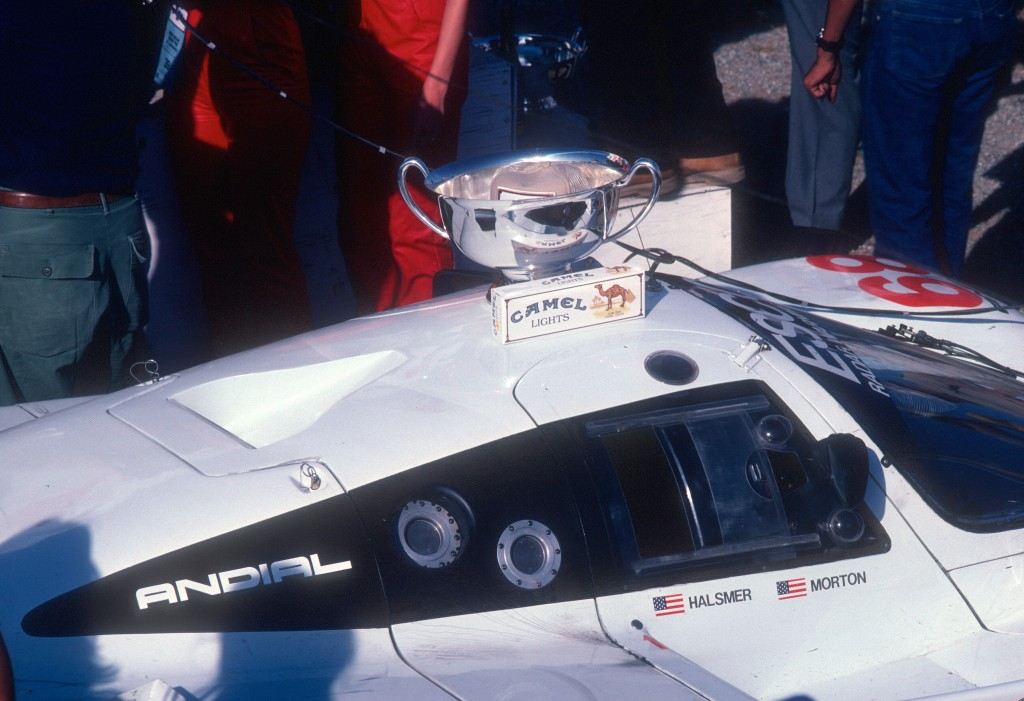 #68_BFGoodrich Porsche 962_ Jim Busby Racing_car with 1st place trophy_Riverside Raceway_April 1985