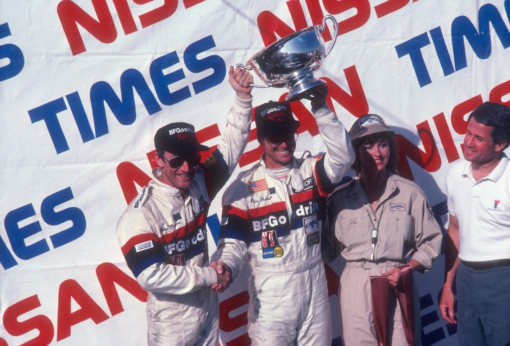 John Morton & Pete Halsmer_first place trophy_car #68_BFGoodrich Porsche 962_LA Times Nissan Grand Prix_April 25, 1985