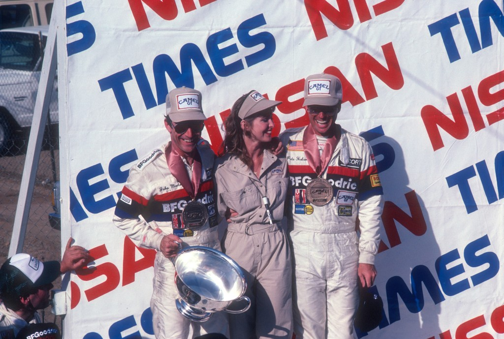John Morton & Pete Halsmer_first place trophy & Camel GT medals_car #68_BFGoodrich Porsche 962_LA Times Nissan Grand Prix_April 25, 1985
