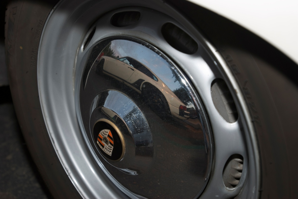Porsche 356 hubcap with 911 reflection_Cars&Coffee/Irvine_12/17/11