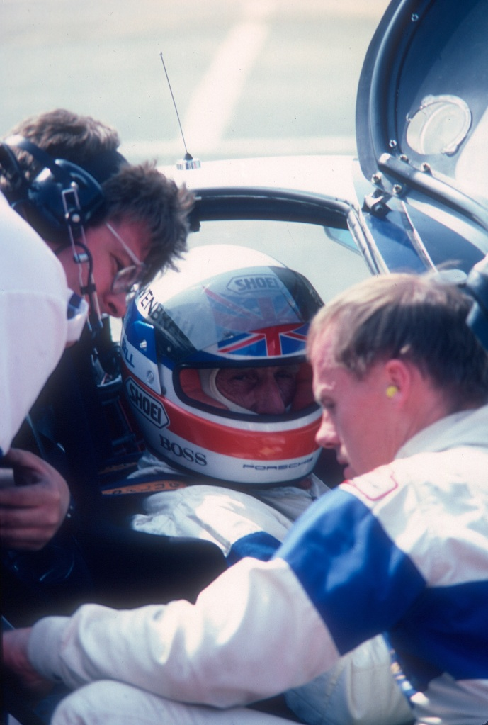 Derek Bell, crew chief Kevin Doran, and the late Al Holbert_#14 Lowenbrau Porsche 962_Riverside Raceway_Apr 86