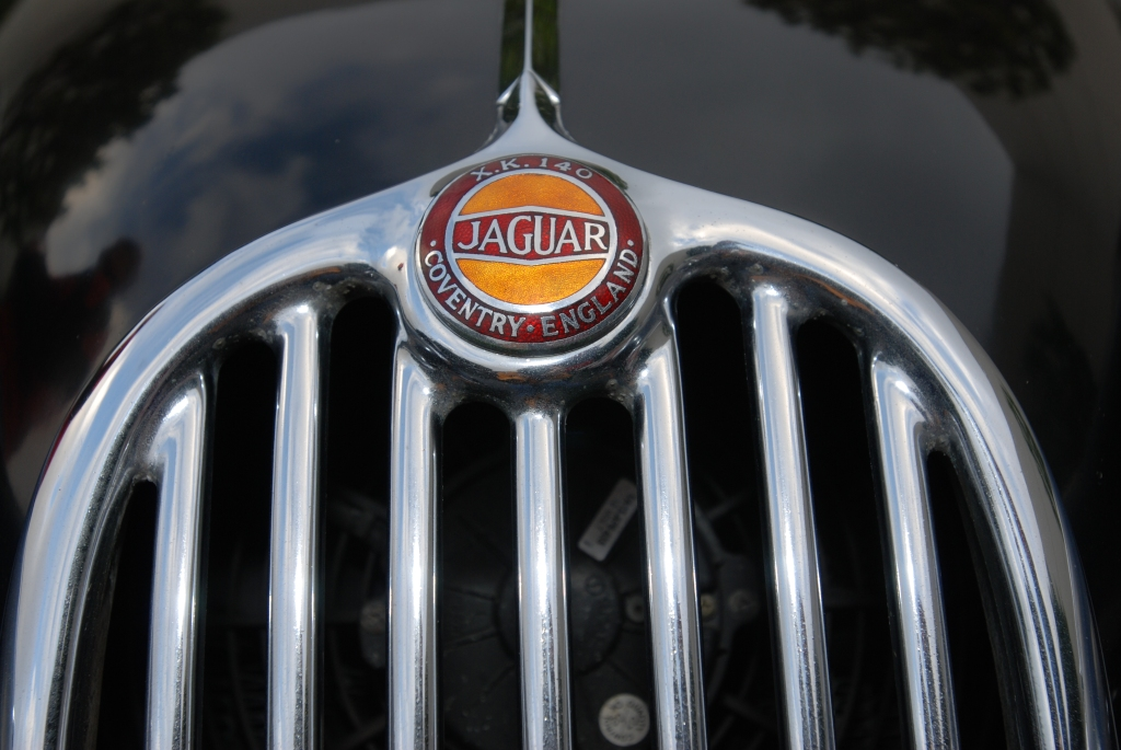 Black on red, 1956 Jaguar XK roadster_grill and hood badge detail_Cars&Coffee/Irvine_2/11/12