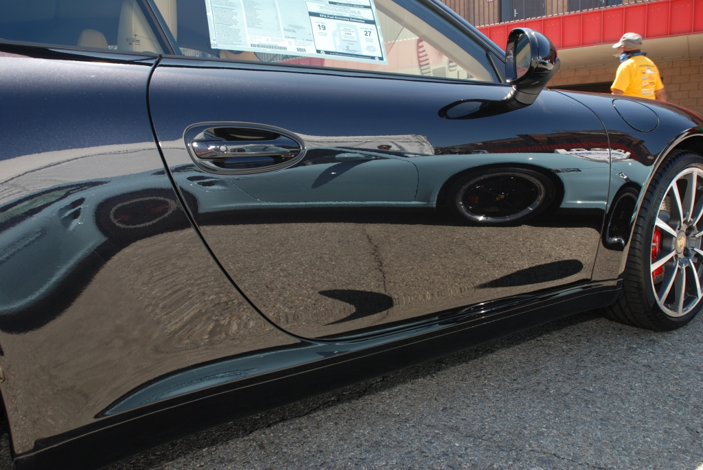 Black Porsche 991 with door reflection_Festival of Speed_Auto Club Speedway_April 21, 2012