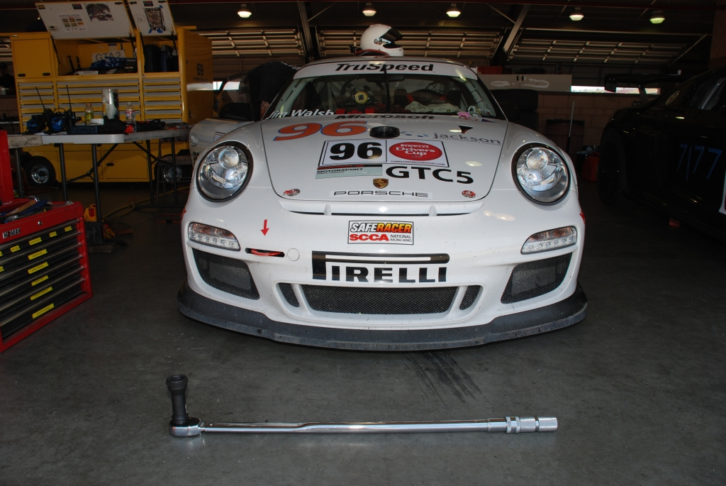 White 2012 Porsche GT3 Cup car #96_ front view with torque wrench_Festival of Speed_Auto Club Speedway_April 21, 2012