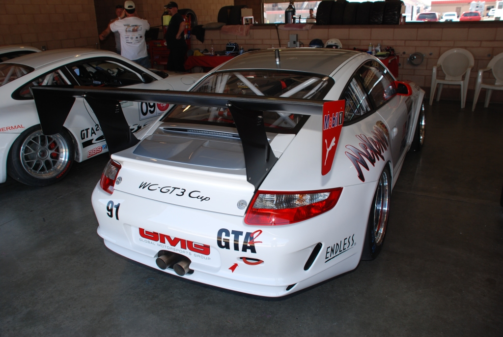 White 2012 Porsche GT3 Cup car_McKEnna graphics_3/4 rear view_Festival of Speed_Auto Club Speedway_April 21, 2012