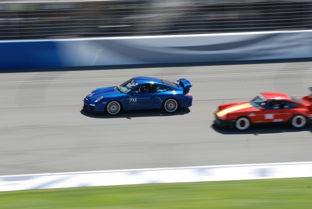 Blue 2011 Porsche GT3 & Red w/ yellow stripe hood 911_Festival of Speed_Auto Club Speedway_April 21, 2012