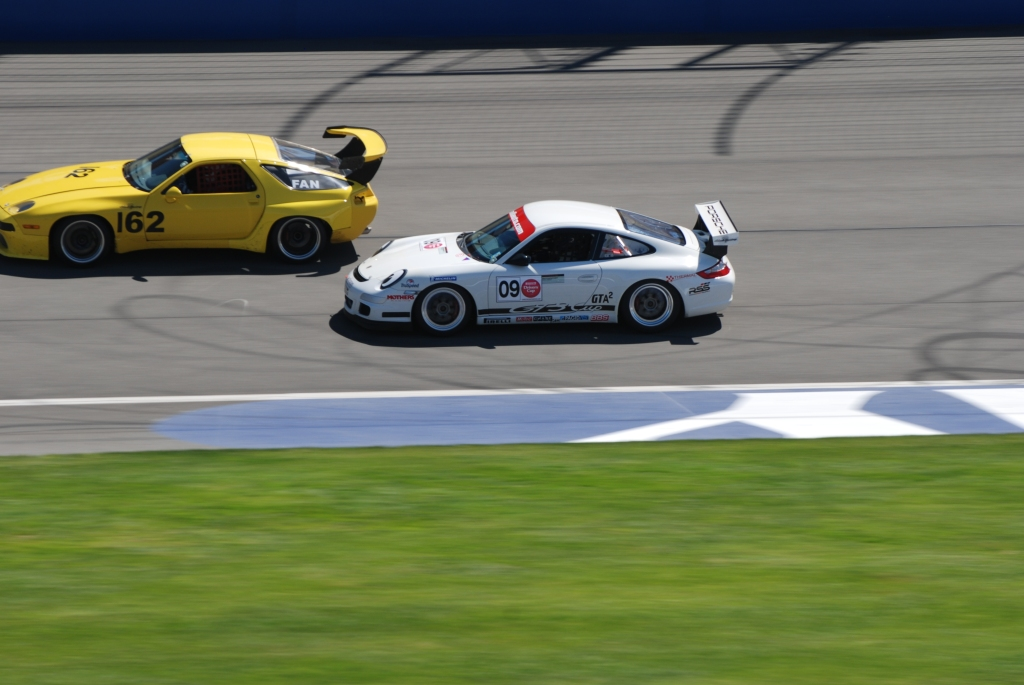 Yellow Porsche 928 & white GT3 Cup_Festival of Speed_Auto Club Speedway_APril 21, 2012