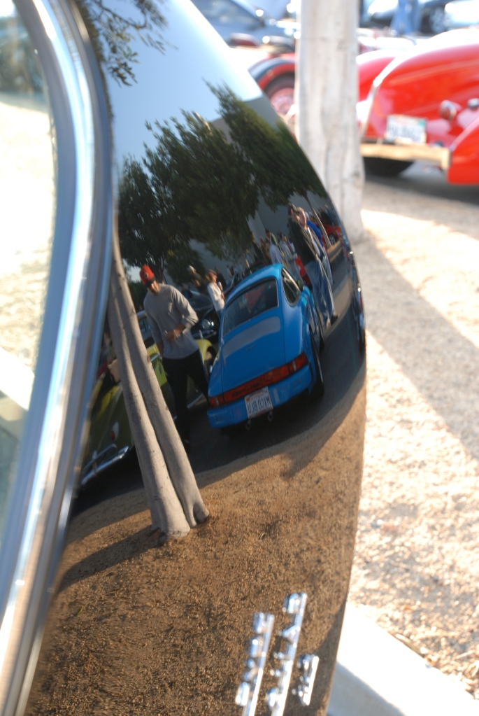 Black Jaguar E Type coupe _rear hatch w/blur Porsche 911 reflection_Cars&Coffee/Irvine_April 28, 2012