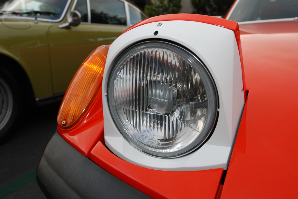 Orange 1970 Porsche 914-6_front headlight with white trim bezel_Cars&Coffee_May 26, 2012
