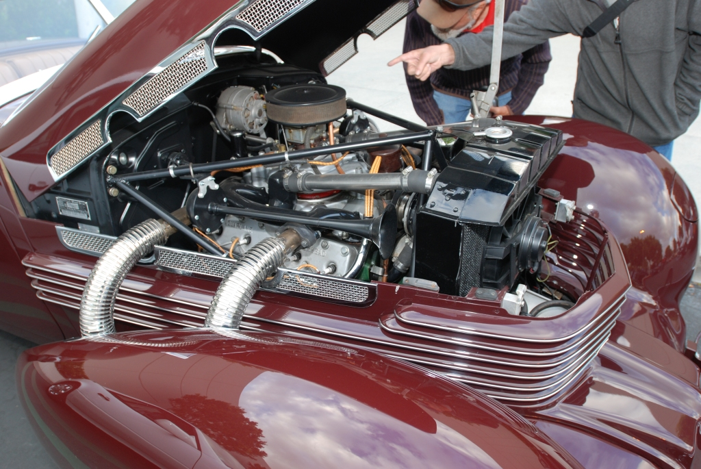 Burgundy 1937 Cord 812 convertible_detail of pontoon fender, engine, exhaust pipes and reflections_Cars&Coffee_May 26, 2012