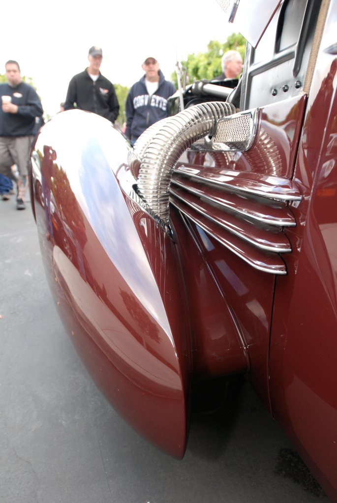 Burgundy 1937 Cord 812 convertible_detail of pontoon fender, exhaust pipes and reflections_Cars&Coffee_May 26, 2012