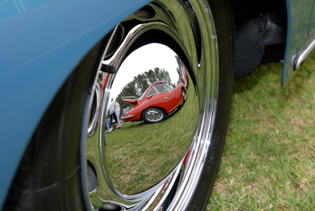 Porsche 356 Registry_ reflection in speedster hubcap/red 356 coupe_Dana Point concours _July 15, 2012