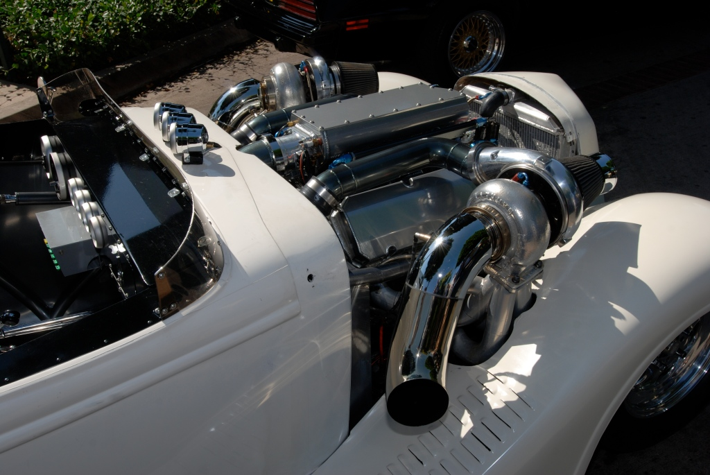 White twin turbocharged roadster_motor detail_12th Annual Uptown Whittier Car Show_August 18, 2012