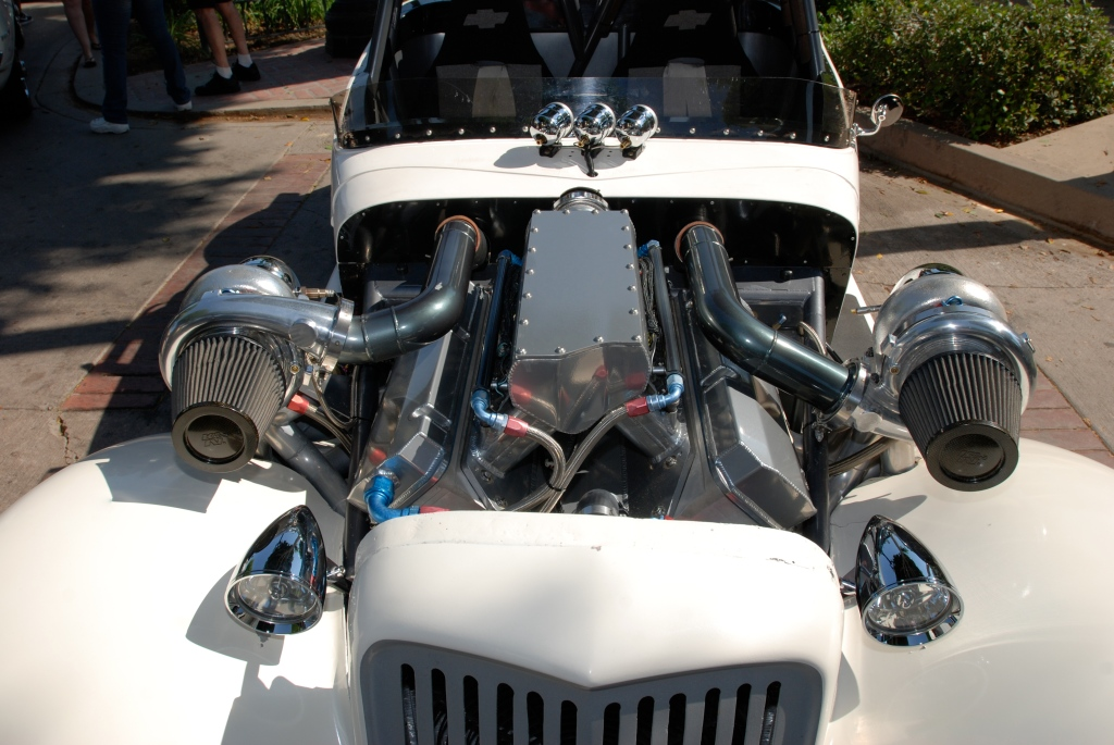 White twin turbocharged roadster_motor/turbo symetry detail_12th Annual Uptown Whittier Car Show_August 18, 2012