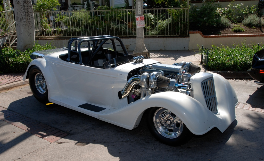 White twin turbocharged roadster_3/4 front view_12th Annual Uptown Whittier Car Show_August 18, 2012