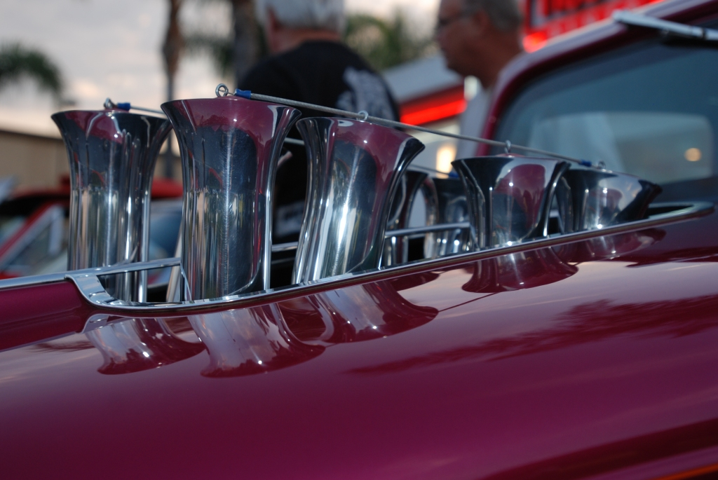 Raspberry colored hot rod_ injection stacks thru hood and reflections_Ruby's Diner car show_ Whittier,California_August 3, 2012