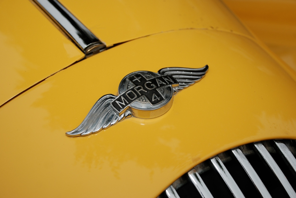 Sunflower yellow hued Morgan Plus 4 roadster_hood emblem_Cars& Coffee_October 20, 2012