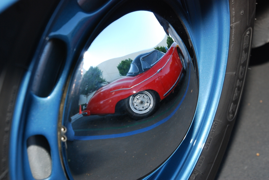 Red 1957 356A Porsche speedster reflection in blue 356A coupe hubcap_Cars&Coffee_October 27, 2012