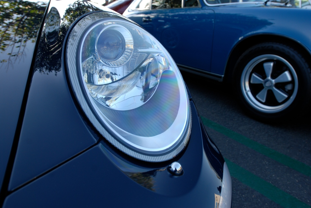 2011 Dark Blue GT3 RS4.0_front headlight detail with blue 911E in background_Cars&Coffee_November 10, 2012