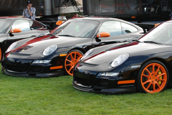 A trio of 2007 Porsche GT3 RS_Black with orange accents_side by side _Rennsport Reunion IV, Laguna Seca_DSC_0010_2