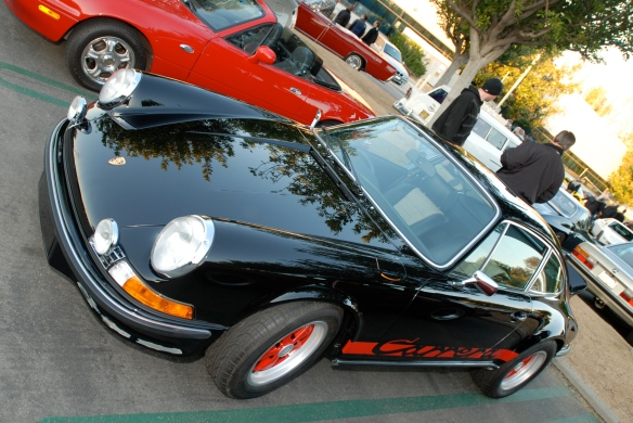 Black 1973 Porsche 911 Carrera RS_right hand drive model_tilted side view with reflections_Cars&Coffee/Irvine_January 5. 2013
