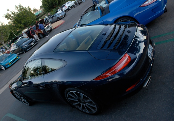 Dark Blue metallic 2013 Porsche type 991, 911 Carrera_3/4 rear view with sunrise reflections_Cars&Coffee/Irvine_January 12, 2013