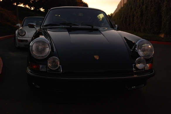 Black 1973 Porsche 911 Carrera RS & white 1991 Porsche 964 turbo_front view w/sunrise lighting_Cars&Coffee/Irvine_January 19, 2013