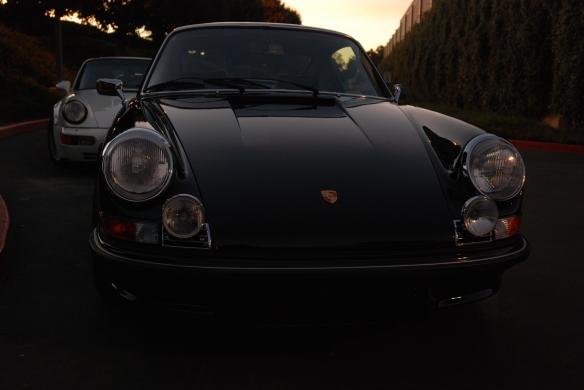 Black 1973 Porsche 911 Carrera RS & white 1991 Porsche 964 turbo_front view w/sunrise lighting_Cars&Coffee/Irvine_January 19, 2013