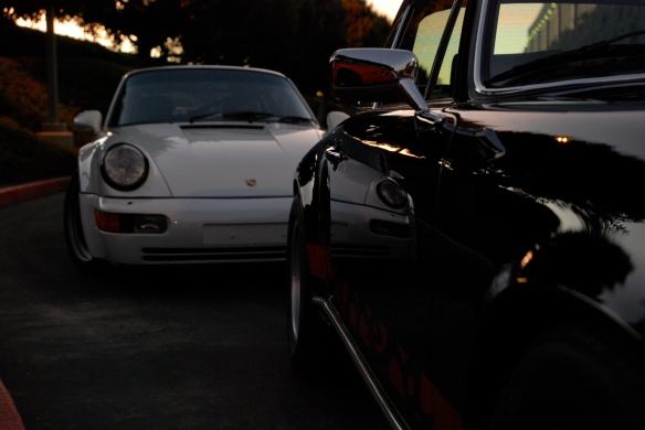 Black 1973 Porsche 911 Carrera RS & white1991 Porsche 964 turbo_ side reflections in Carrera RS w/sunrise lighting_Cars&Coffee/Irvine_January 19, 2013