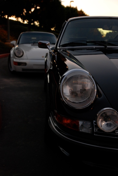 Black 1973 Porsche 911 Carrera RS & white1991 Porsche 964 turbo_ Carrera RS headlight & hood reflections_Cars&Coffee/Irvine_January 19, 2013