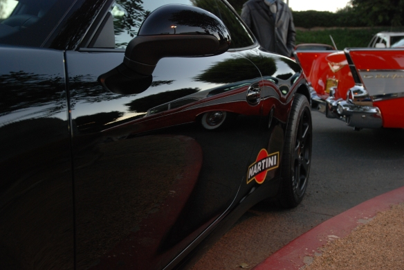 Black 2013 Porsche type 991 / 911 Carrera_side view with sunrise and red chevrolet reflections_Cars&Coffee/Irvine_January 19, 2013