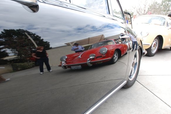 Red Porsche 356 reflection in door of black 356 coupe_Phoenix club all Porsche Swap & Display_3/03/13