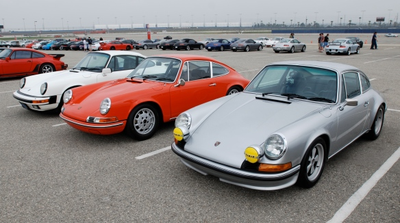 Father and son Porsche 911s_Orange 911T and Silver 1972 Porsche 911S _Porsche Corral__3/4 front view__California Festival of Speed_April 6, 2013