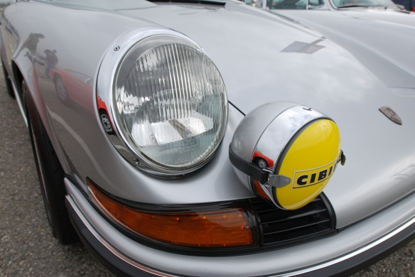 Silver 1972 Porsche 911S  from trio of one family's three Porsche 911s _Porsche Corral_fender reflections, headlight and foglight details_California Festival of Speed_April 6, 2013