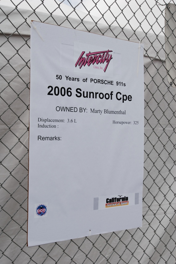 50th anniversary  of the Porsche 911 display_ Silver 2006 997 coupe biography _California Festival of Speed_April 6, 2013