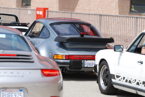 50th anniversary  of the Porsche 911 display_1984 930 Turbo & friends on pit row_California Festival of Speed_April 6, 2013