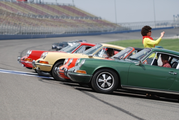 50th anniversary  of the Porsche 911 display_early 911s aligned on banked track for group photo_California Festival of Speed_April 6, 2013