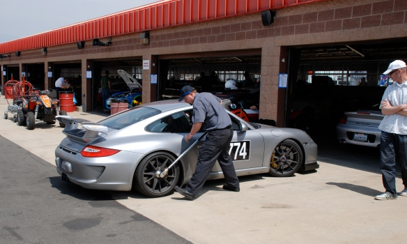 Silver Porsche GT3_re-torquing the wheels_Garage 3_3/4 rear view_California Festival of Speed_April 6, 2013