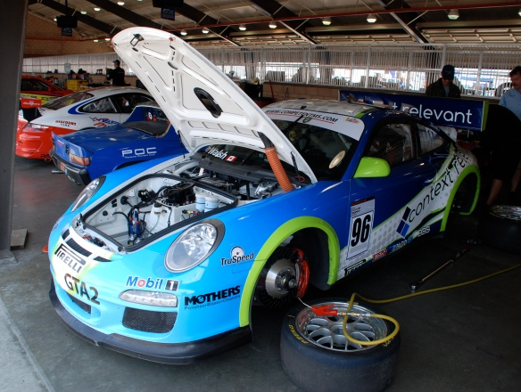White, blue and fluorescnt green trimmed Context Relevant Porsche GT3 Cup car#96_3/4 front view_Garage 3_California Festival of Speed_April 6, 2013