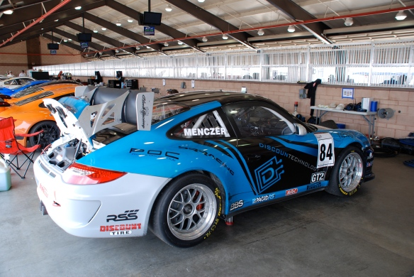 Blue, Black and white, DiscounTechnology Porsche GT3 Cup car_ Garage 3_3/4 rear view_California Festival of Speed_April 6, 2013
